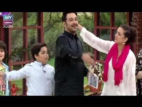 "Faysal Qureshi playing with kids ""Find the Word"""